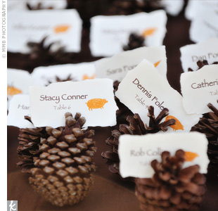 For the DIY escort cards, Malissa printed out each guest's name onto hand-ripped paper and stamped the cards with a pig, chicken, or carrot depending on the guest's meal choice. The cards were set on a bed of pinecones at the reception entrance.