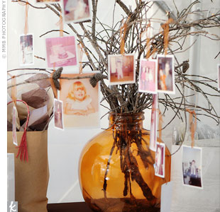 Baby pictures of Malissa and Paul were hung from branches (which the couple had gathered from the ceremony site) that had been placed in an orange glass jar.