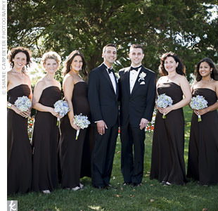 Brian and Josh's bridesmaids wore strapless, floor-length, chocolate-brown dresses from Ann Taylor and carried blue bouquets designed by Somers Point Florists.