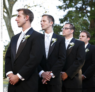 The groomsmen rented tuxes from Men's Wearhouse. Baby blue vests and ties coordinated with the blue and brown color scheme.