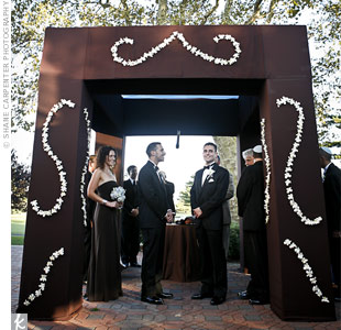 Brian and Josh were married under an elegant huppah, which their florist fashioned out of pressed box fabric and white flowers.