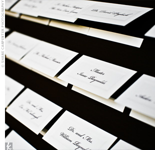 For their guests' escort cards, the couple's florist created a brown display board for the entrance to the reception.