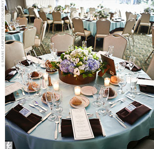 The couple paired brown and blue (one of Brian's favorite colors) for their wedding colors, which reinforced the beach theme.