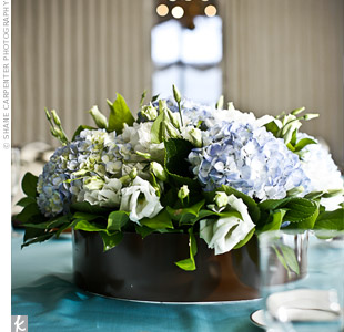 Blue hydrangea centerpieces sat on all the reception tables, which were covered in blue linens.