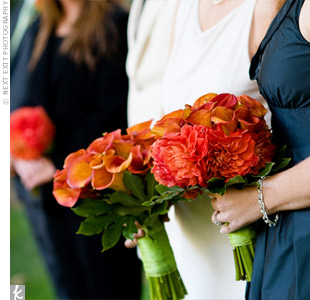 All the bouquets consisted primarily of mango calla lilies. Jaymi and Kerri chose the color orange for the way it pops against an earthy green.