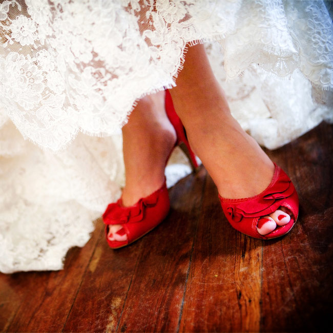 "The bride wore bold red shoes to go with her favorite ""Angel Red"" lipstick by Clinique. The bridesmaids loved the vintage look so much, they borrowed the lipstick to coordinate with their bouquets."