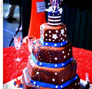"""Fireworks"" made of streamers topped the Fourth of July-themed fondant cake decorated with stars and stripes. A champagne ""gelee"" (think something along the lines of a Jello shot) accompanied each slice."