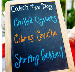 Chalkboards outlined the different options at each food station, including seafood favorites like raw oysters, chilled shrimp cocktail and fish tacos. Jennifer's only rule: No steak! She wanted the menu to reflect the seaside location.