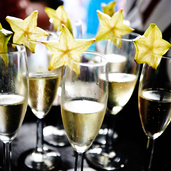 "The father-of-the-bride gave a toast as guests held up champagne glasses garnished with star fruit (to look like starfish). Throughout the night, guests also sipped ""orangetinis"" made with citrus vodka."