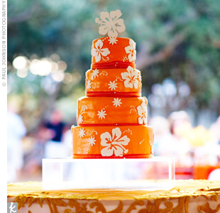 The same hibiscus design used in the couple's stationary decorated the top tier of their fondant cake.