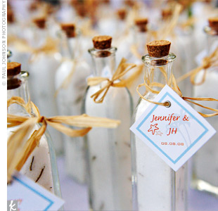 Guests took home corked bottles of rosemary and salt for cooking. Jennifer decorated each bottle with a seashell or starfish tag and had them displayed with the guest book to fill out the table.
