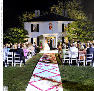 At the ceremony, hot pink roses decorated the aisle, and the driveway was lined with pink, white, and green flowers. A string quartet added to the ambience.