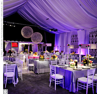 The reception took place beneath a large tent, where elaborate lighting and platinum table linens set an elegant tone for Sara and Bryan's Southern wedding.