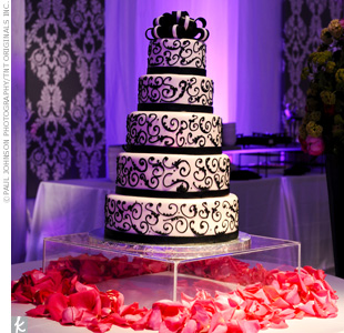 Sara and Bryan's five-tiered wedding cake was decorated with black and white fondant.