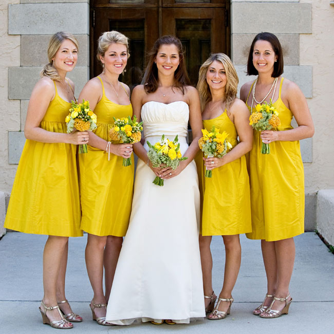 The four bridesmaids chose tea-length taffeta J.Crew dresses with crisscrossed spaghetti straps and buttons in the back. Marissa altered her own dress to include buttons as well.