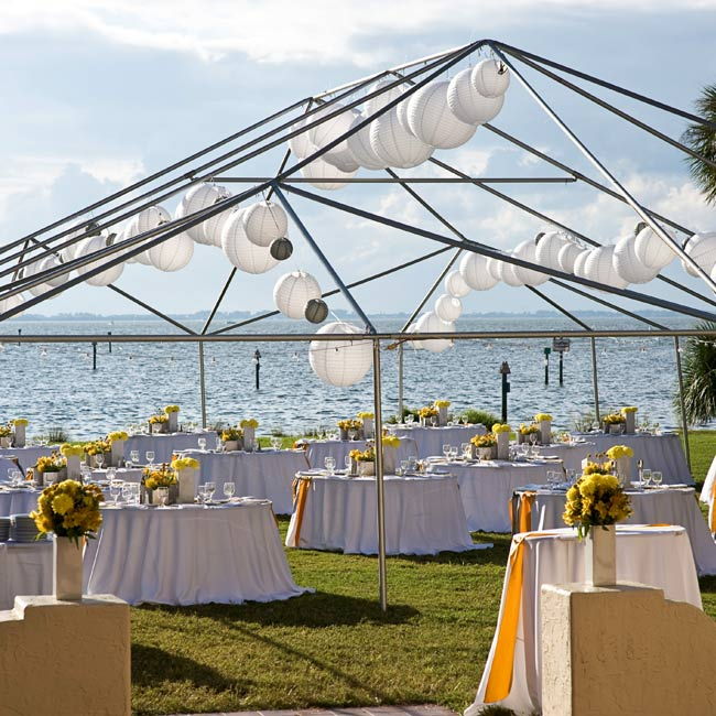 Marissa wanted the reception space to feel open, and thought a tent would obstruct the beautiful view. So instead, she just rented tent poles -- a move that saved her more than half of what a covered tent would cost -- to serve as a frame for the dining area.