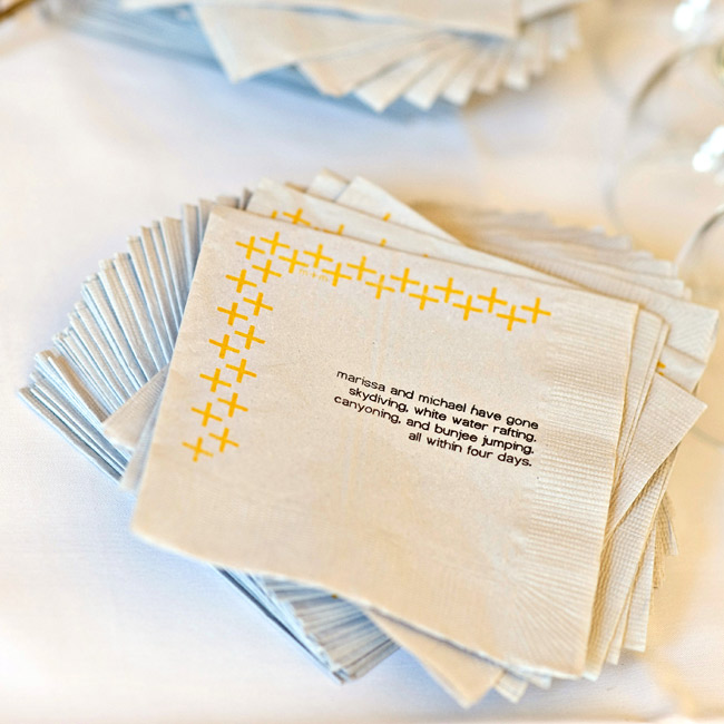 Napkins printed with fun facts about the couple also included a plus-sign border.