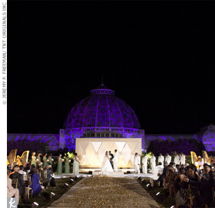 In the background of Jaenelle and Nykolas' wedding ceremony, purple patterned lighting illuminated the venue.