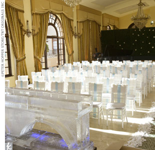 The theme of Kellie and Gabe's wedding ceremony was a winter garden in Paris. The blue-tiled aisle was designed to look like ice, and guests' seats were covered with white mink to resemble snow.