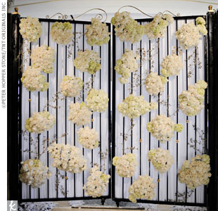 Kellie and Gabe entered the ceremony through a wrought-iron gate decorated with white flowers.