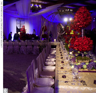 Guests sat at long tables beneath swooping fabric and chandeliers.
