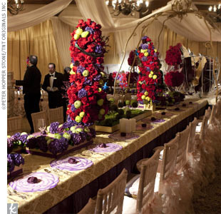 Red and plum-colored flowers adorned each table and were accented with fresh green apples.