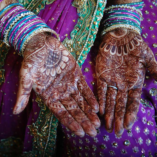 At the sangeet, an event the night before the wedding where the bride's family performs songs and dances, Sonia showed off her mehndi, elaborate henna designs on her hands.