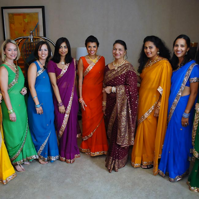 Although not part of most Hindu weddings, Sonia chose to include the Western tradition of having bridesmaids. They wore saris from India in a rainbow of colors. The gold accents unified the look.