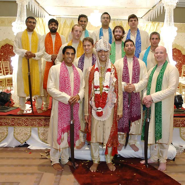 Like the rest of the attire, the groom's and groomsmen's kurtas came from overseas. Their scarves matched the colors of the bridesmaids' saris for a cohesive bridal party style.