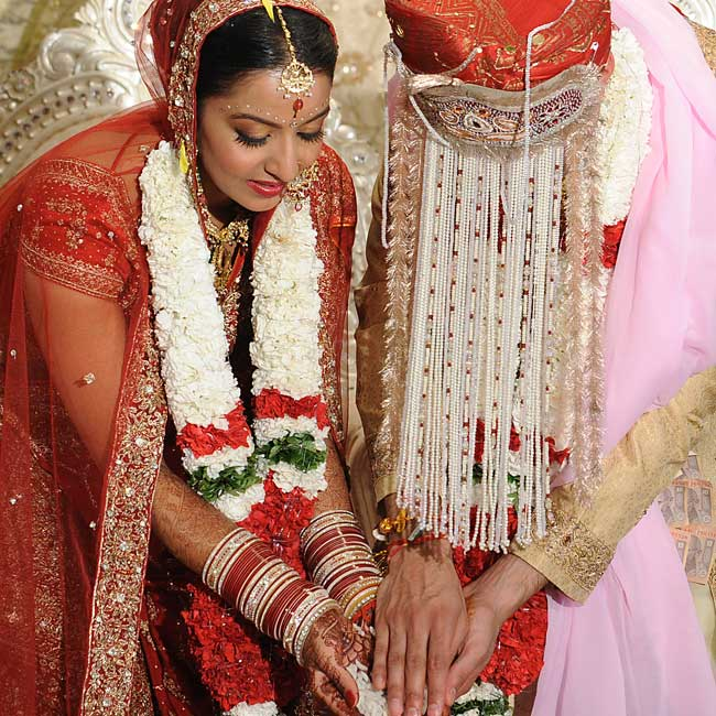 As a symbol of their mutual acceptance, the couple exchanged garlands of flowers during the ceremony. The garlands' red, white and green colors complemented their attire.