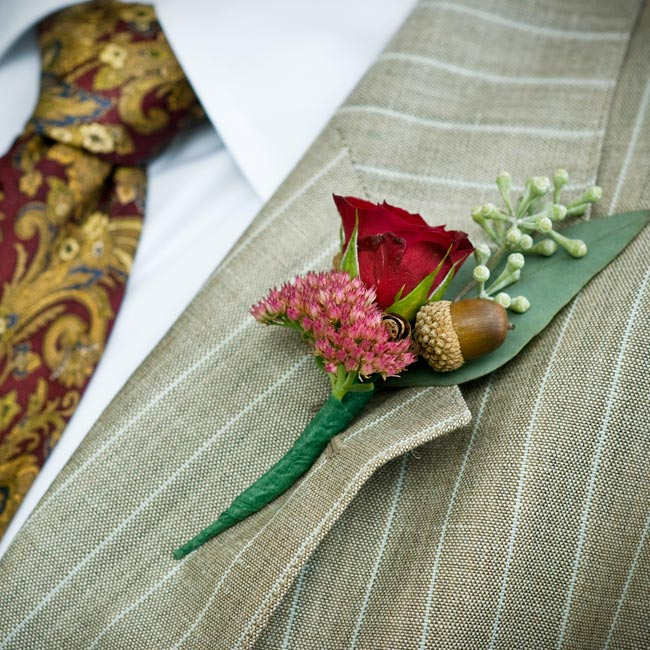 An acorn -- Sean's pet name for Terri -- personalized the rose, seeded eucalyptus and sedum boutonniere.