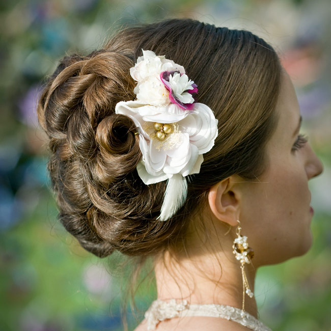 A feather and some gold beads were retro-glam accents to Terri's floral hairpin.