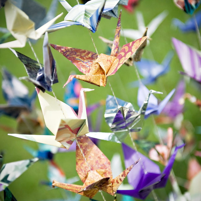 "In many Asian cultures, having 1,000 origami cranes at the wedding is thought to bring the couple good luck. To honor Sean's Buddhist beliefs, the couple and their friends made a bunch and hung them from strings. ""We ended up with 1,083—too many helping hands!"" says the bride."
