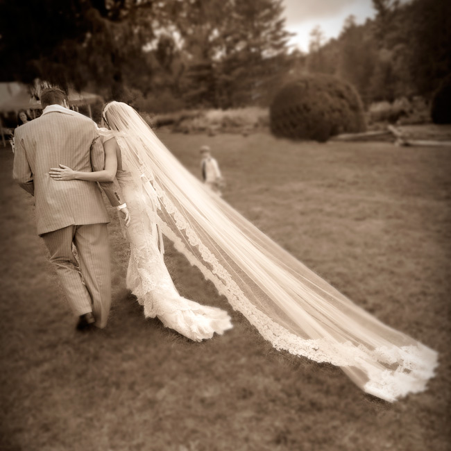 For a truly personal touch Terri's mom handmade her cathedral-length veil. Its lace edge matched her gown.