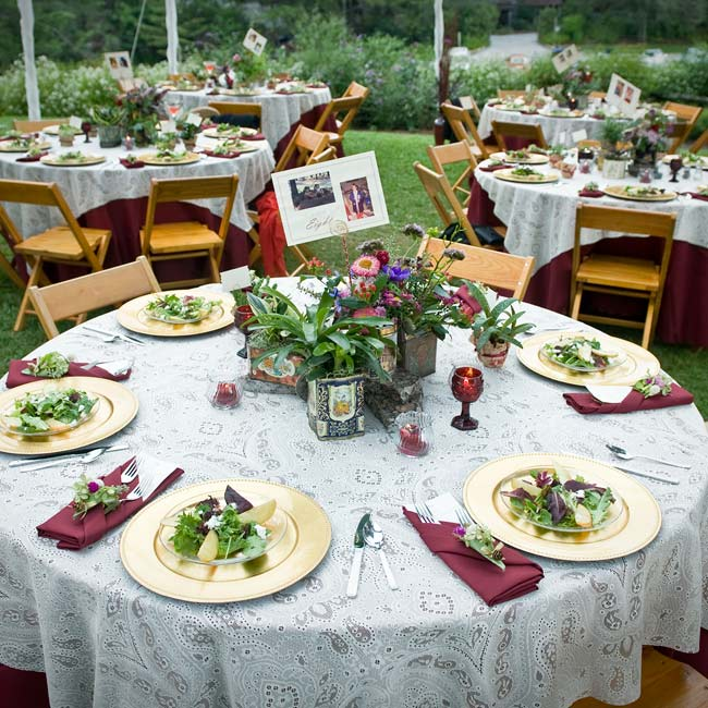 The bride's mother made the paisley tablecloths that covered the wooden dining tables. Gold chargers and wine-colored napkins, candles and goblets fit in with the color scheme.