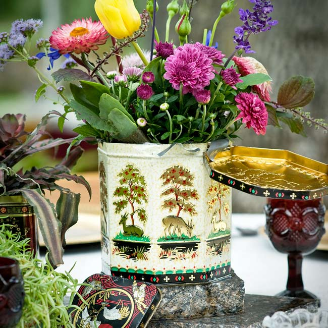 Blooms in vintage tins and antique glass vases played up the theme. The colorful mix included straw flowers, zinnias, mums, tulips, delphiniums and salvias.