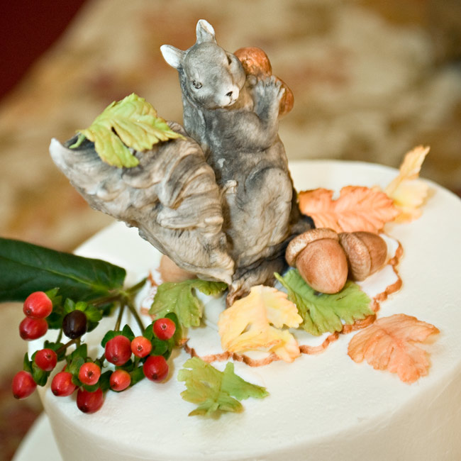As a surprise for Sean, the cake baker sculpted a sugar-paste squirrel and acorn. Inside, a gluten-free, dairy-free carrot cake was made especially for the groom who has wheat and dairy allergies.