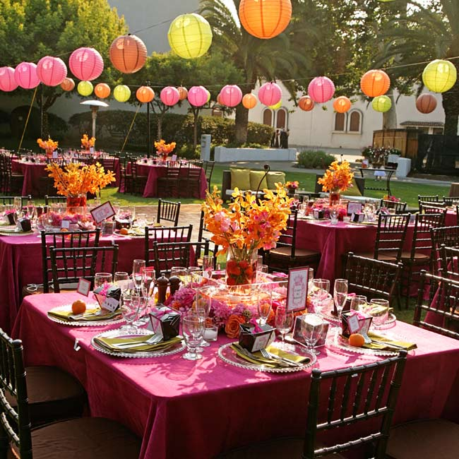 Strings of pink, orange, and chartreuse lanterns defined the reception space and added a festive feel to the vineyard setting.
