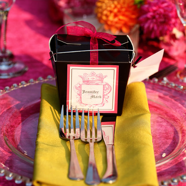 Take-out containers personalized with a Juicy Couture-esque logo waited for guests at their place settings. They were empty, but the attached instructions directed guests to fill their boxes at the candy table.
