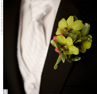 Matthew and his groomsmen wore green dendrobium orchid boutonnieres with hypericum berry accents. The pink berries on Matthew's boutonniere made him stand out from the rest.