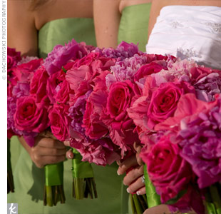Kristin's bridesmaids carried bright pink bouquets made of hydrangeas, peonies, and roses. The bouquets were tied with kiwi green ribbon to coordinate with their dresses.