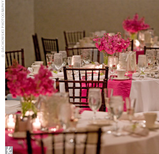 At the reception, guests sat at tables decorated with pink stock and topped with dupioni silk table runners, which Matthew's mother had sewn in the months leading up to the wedding. Mahogany chiavari chairs gave the room a tropical feel.