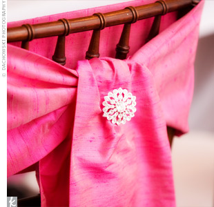 Matthew's mother made the dupioni silk sashes, accented with crystal brooches, for the couple's chairs.