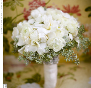 Megan's bouquet of white gardenias and ranunculus was wrapped with a silk ribbon and a crystal bracelet which had belonged to her grandmother.
