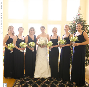 Megan's strapless, trumpet-style, ivory, silk radzimir gown had a vintage look with silver French knotting and crystal appliques on the bodice. Her bridesmaids wore navy blue jersey dresses with Empire waists by Amsale.