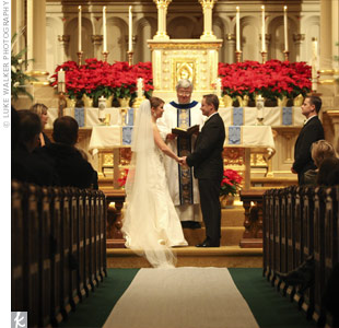 "To add a touch of holiday spirit to their ceremony, the altar was flooded with festive poinsettias and ""Joy to the World"" was played during the recessional."