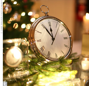 Alluding to the New Year's festivities ahead, clocks, set at five minutes to midnight, decorated the escort card table.