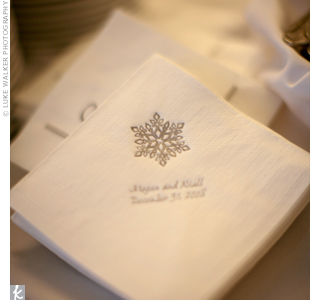 The couple designed their cocktail napkins using a silver snowflake motif and served three signature holiday cocktails: the Gingerbread Man, the Snowball, and the Pomegranate Cosmopolitan.