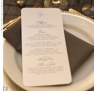 Silver napkins and beaded chargers coordinated with the crystal-embellished menu cards. The couple gave their guests a choice of lobster tail, filet mignon, or Chilean sea bass for the main course.