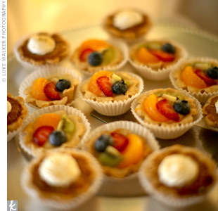 In addition to wedding cake, the couple treated guests a large dessert station, which included pastries, creme brulee, truffles, cookies, and mixed-fruit and pumpkin mini tarts.